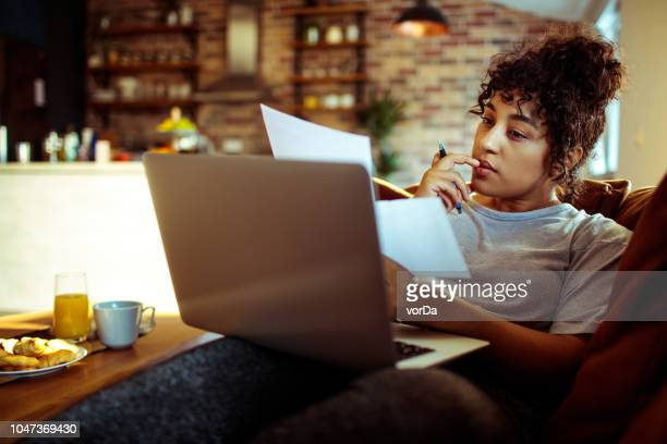 woman doing bills - home finances stock pictures, royalty-free photos & images