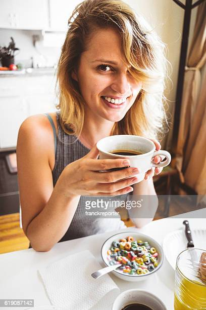 woman doing breakfast on the morning with coffee
