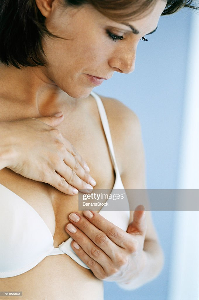 Woman doing breast self exam : Stock Photo