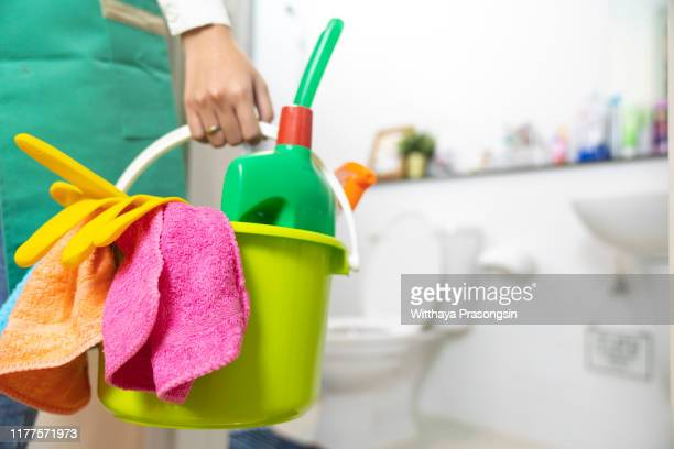 woman doing chores cleaning bathroom at home - maid stock pictures, royalty-free photos & images