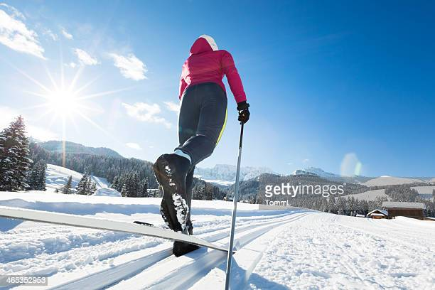 woman doing cross-country skiing - langlaufen stockfoto's en -beelden