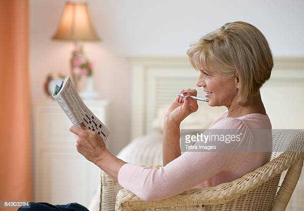 Woman doing crossword puzzle