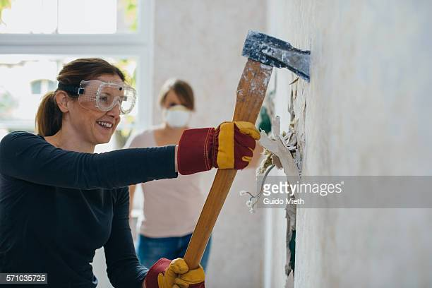 woman doing demolition. - demolishing stock pictures, royalty-free photos & images