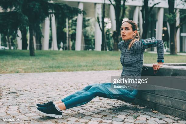 Woman doing dips outdoors