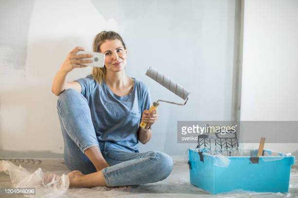 woman doing diy project in apartment - whitewashed stock pictures, royalty-free photos & images