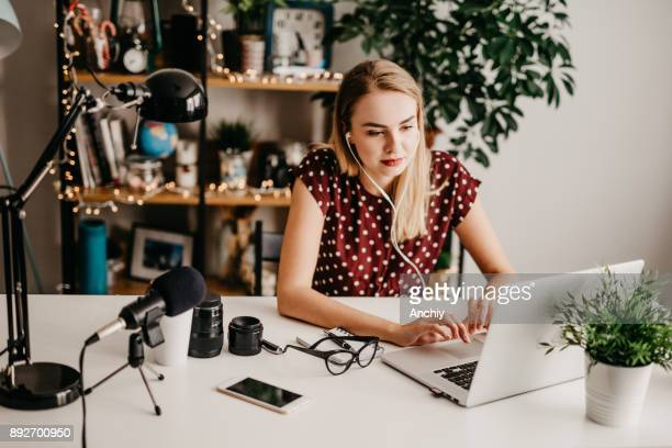 woman doing editing for her vlog - editor stock pictures, royalty-free photos & images