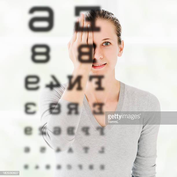 Woman Doing Eye Exam at Optometrist
