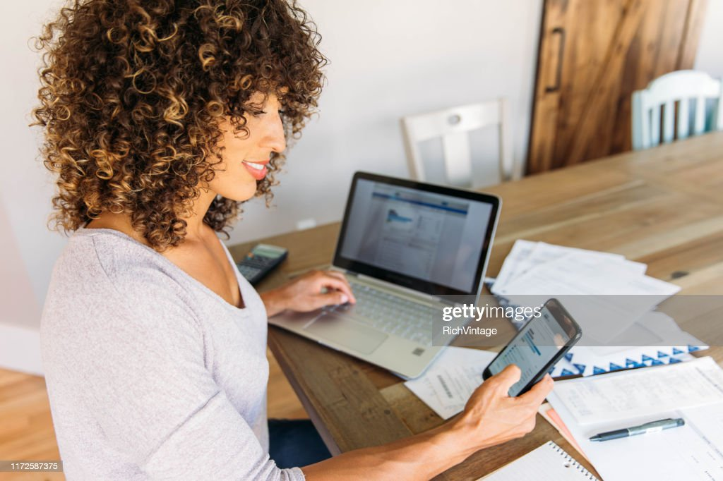 Woman Doing Finances at Home on Smart Phone : Stock Photo
