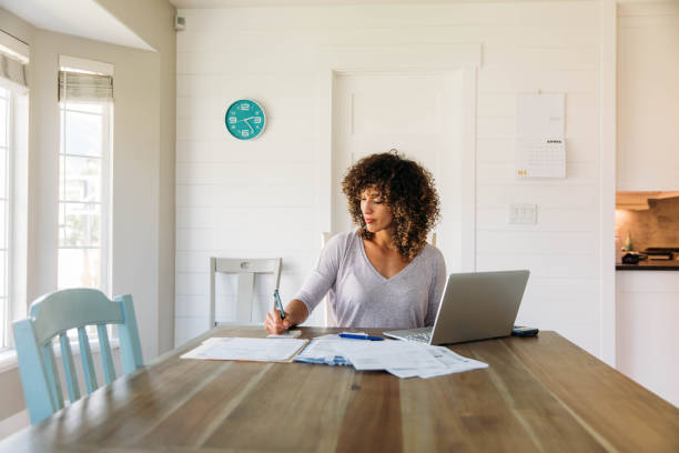 woman doing finances at home - preparation stock pictures, royalty-free photos & images