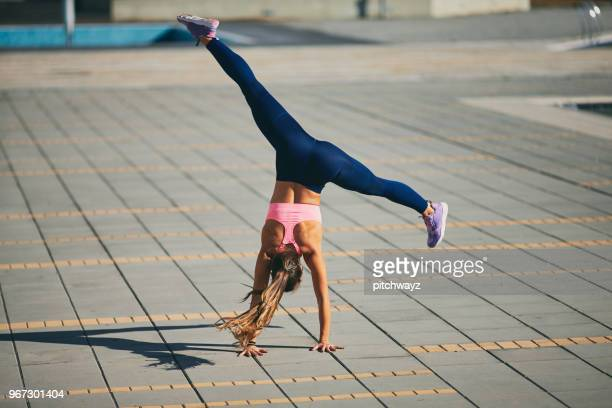 woman doing fitness exercises. - cartwheel stock pictures, royalty-free photos & images