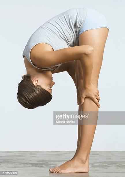 Woman doing forward bend