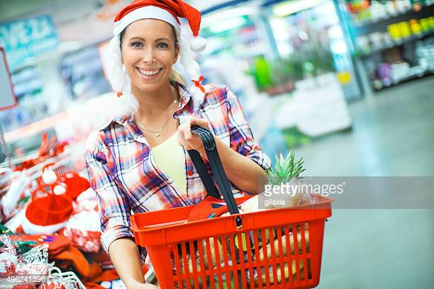 Woman doing grocery shopping in supermarket.