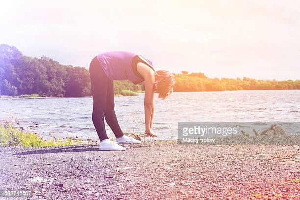 a woman doing gym near a lake - county cavan stock photos and pictures