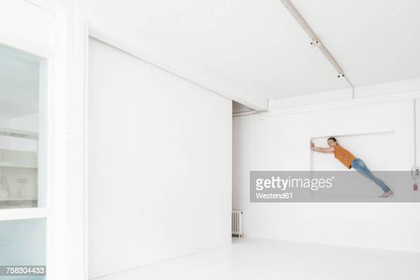 Woman doing gymnastics in niche of a loft