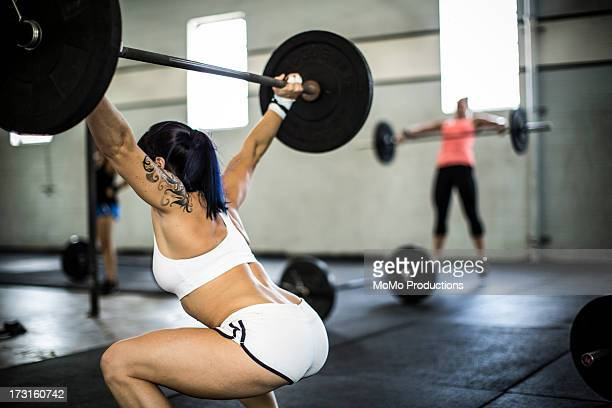 woman doing gym/snatch