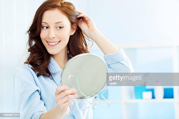 Woman Doing Hairdress in Bathroom