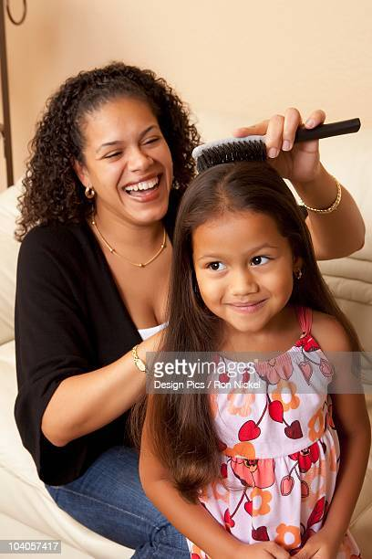 Woman Doing Her Daughter's Hair