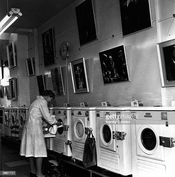 A woman doing her washing in a laundrette picture gallery Harrow London
