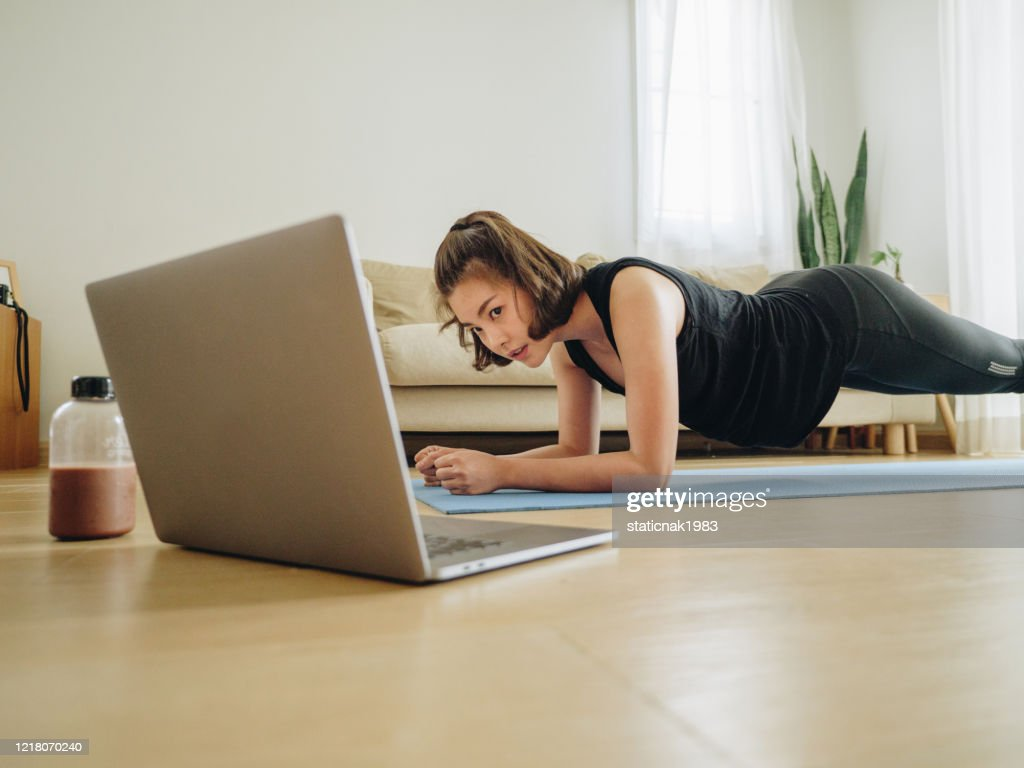 Woman doing home workout in living room at home. : Stock Photo