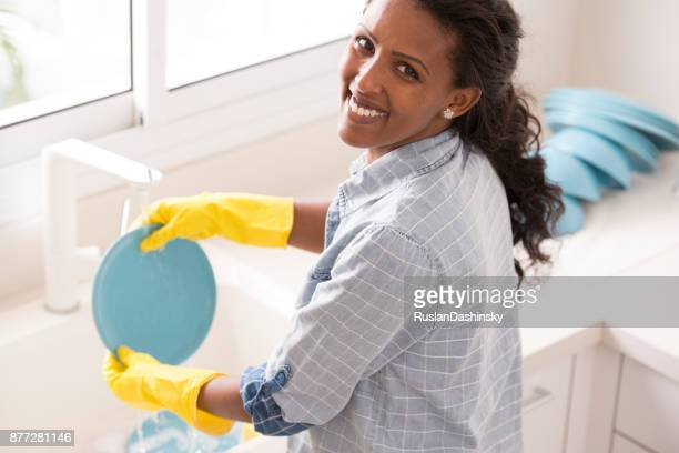 Woman doing house chores.