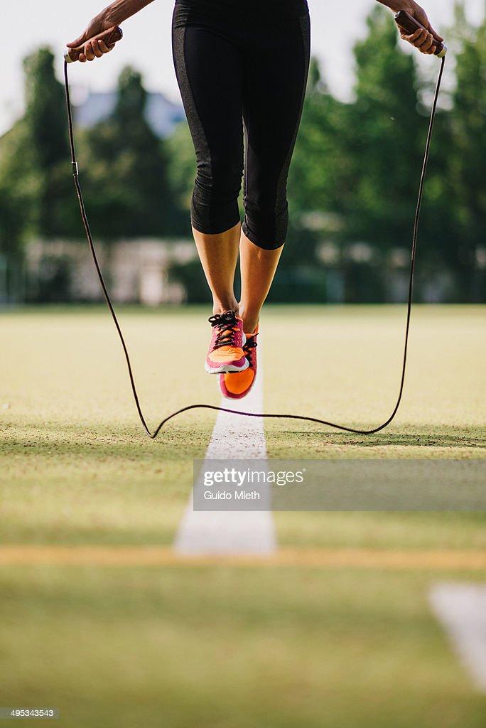 Woman doing jump roping. : Stock Photo