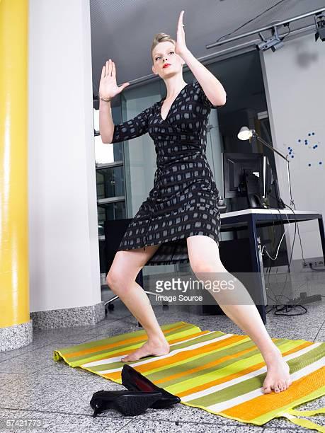 Woman doing karate in office