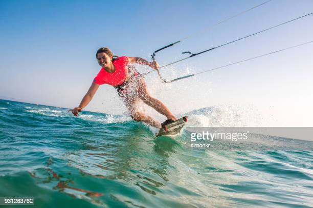 woman doing kitesurfing - wear red day stock photos and pictures