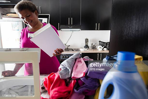 Woman doing laundry, Cape Town, South Africa