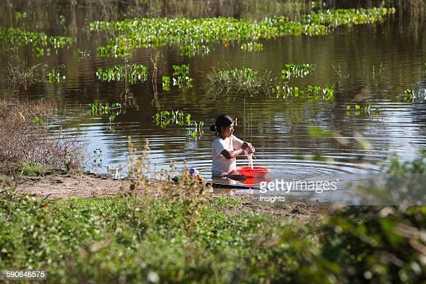 Woman Doing Laundry In A Lagoon Near Carmen Ruiz Santa Cruz Department Bolivia