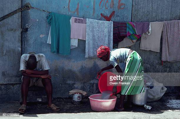 Woman Doing Laundry in Port au Prince Slum