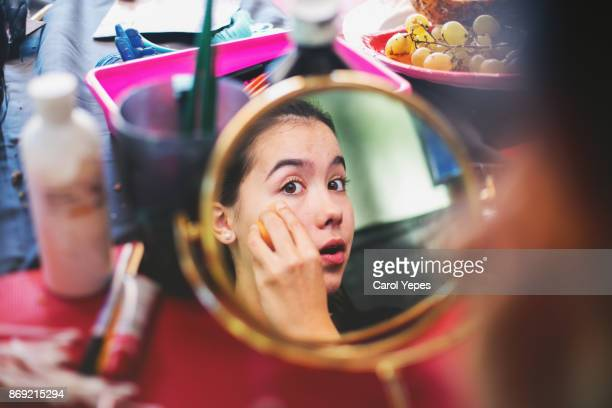 Woman doing makeup at home
