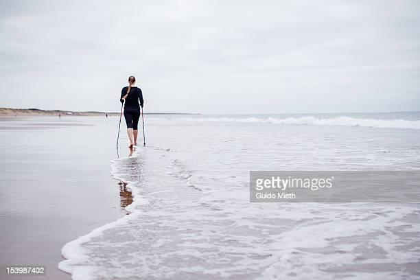 Woman doing nordic walking.
