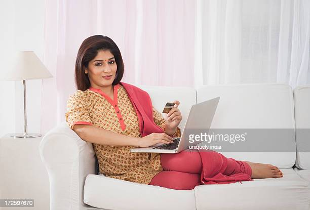 woman doing online shopping with a credit card - salwar kameez stock photos and pictures