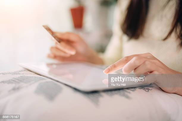 woman doing online shopping with digital tablet - yiu yu hoi stock pictures, royalty-free photos & images
