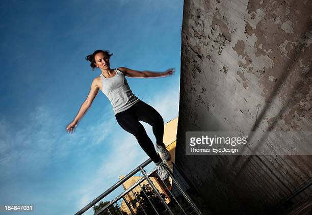 Woman doing Parkour Tic-Tac
