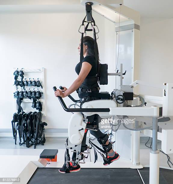 Woman doing  physical therapy on a machine