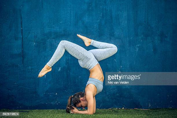 Woman doing Pincha Mayurasana