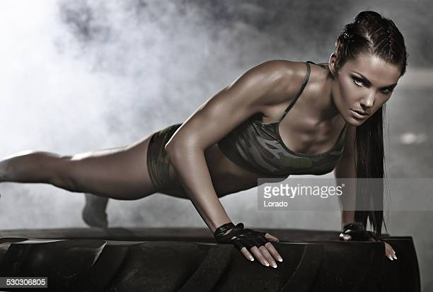 woman doing press ups on tire