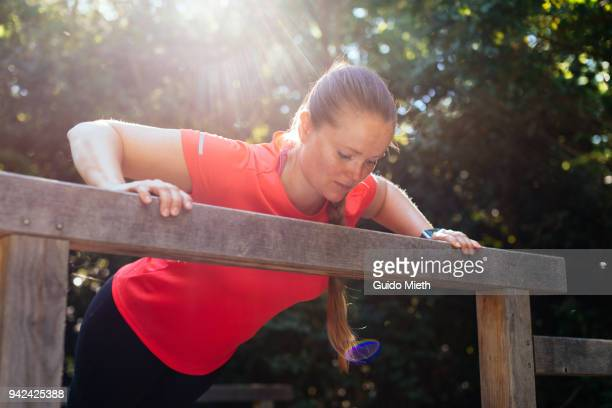 Woman doing push up outdoor.