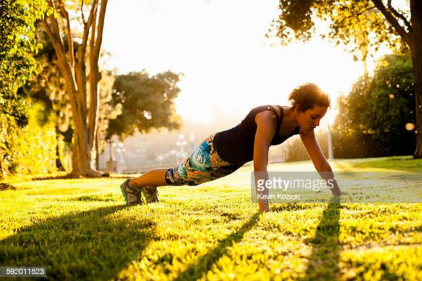 woman doing push ups in park - pasadena california stock pictures, royalty-free photos & images