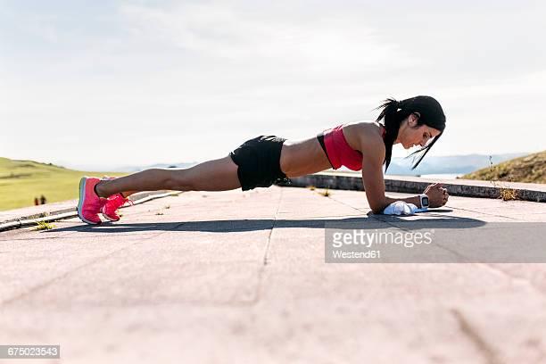 Woman doing push ups, outdoor