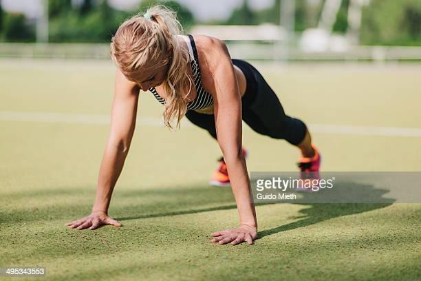 Woman doing pushup.