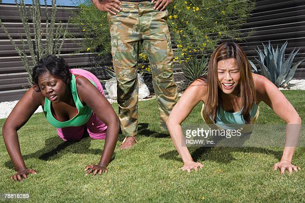 woman doing pushups - curvy asian woman stock pictures, royalty-free photos & images