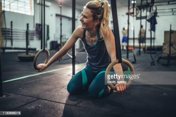 woman doing ring exercises - south_agency stock pictures, royalty-free photos & images