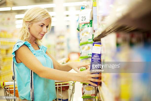 Woman doing shopping of cereals.