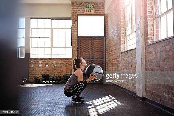 woman doing sqaud traing with ball at gym - medicine ball stock pictures, royalty-free photos & images