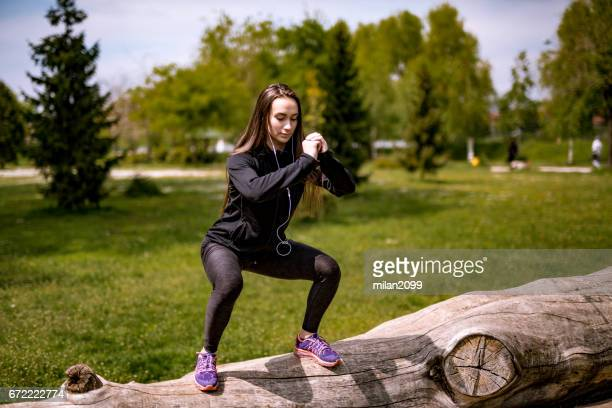 woman doing squats - milan2099 stock photos and pictures