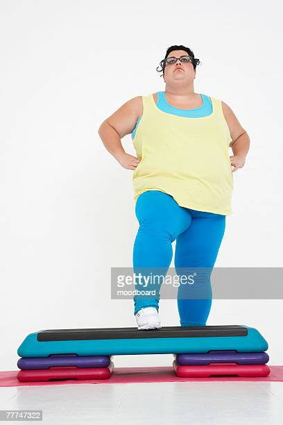 Woman Doing Step Aerobics