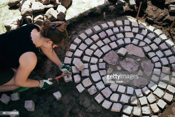 Woman doing stone ring diy project.