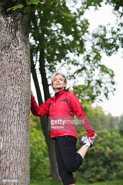 A woman doing stretching exercises Stockholm Sweden.